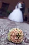 Winter wedding bouquet on snow. newlyweds kiss Royalty Free Stock Photography