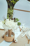 Winter wedding decoration with cotton flower in banquet. Bridal bouquet of white carnations, peony, roses flowers in Stock Photography