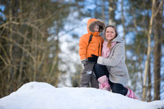 Winter weekend. Mother and son on beautiful winter day outdoors stock images