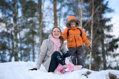 Winter weekend. Mother and son on beautiful winter day outdoors stock photos