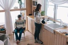 Winter weekend in cozy cabin stock images