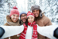 Winter weekend. Friendly young people making selfie on winter weekend Royalty Free Stock Images