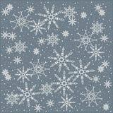 Winter, Weihnachten, Weihnachtshintergrund von weißen Schneeflocken auf einem Pastellblau Lizenzfreies Stockbild