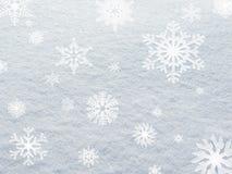 Winter-Weihnachtshintergrund-Dekorschneeflocken auf Schnee Stockfotos