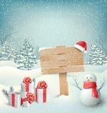 Winter-Weihnachtshintergrund mit Wegweiser-Schneemann und Geschenkboxen Lizenzfreies Stockbild