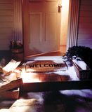 Winter welcome mat with open door Royalty Free Stock Image