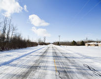 Winter in Western New York. Deserted snow-covered road outside Buffalo, New York stock images