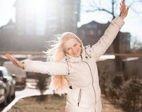 Winter white down jacket, half height, smile royalty free stock images