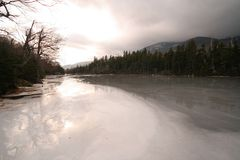 Winter in the White Mountains. Semi - frozen lake, taken in the White Mountain National Forest, New Hampshire Stock Photos