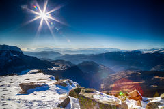 Winter white snowy mountains and green conifers Royalty Free Stock Photo