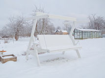 Winter white swing under the snow Stock Photo