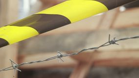 Winter wind yellow tape barbed wire, do not cross sign. Stock footage stock video