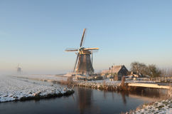 Winter windmill landscape in Holland Royalty Free Stock Images