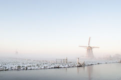 Winter windmill landscape in Holland Stock Image