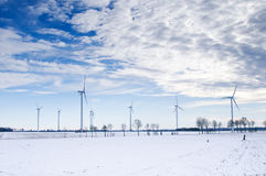 Winter windmill park. In a white snow landscape with blue sky and clouds Stock Photography