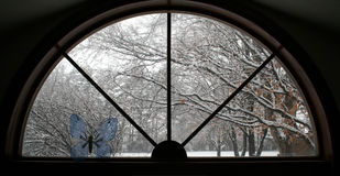 Winter Window. How the garden changes its appearance in winter, contrast this same window in fall Royalty Free Stock Photo