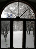 Winter Window. How the garden changes its appearance in winter, contrast this same window in fall Stock Image