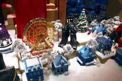 Winter Window Display. Wintery decorated window display with snow, small houses and a Ferris wheel. Printemps department store, Paris, France Stock Image