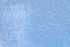 Winter in the window: ice flowers, frost flowers, frozen window. Royalty Free Stock Images