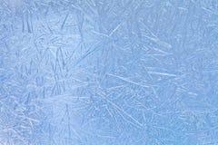 Winter in the window: ice flowers, frost flowers, frozen window. Royalty Free Stock Images