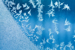 Winter window and ice flowers pattern background. cold weather concept. soft focus shallow depth of field Royalty Free Stock Images