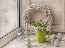 Winter window with snowdrops on the eve of holidays Royalty Free Stock Image