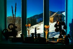 Winter in the window sunny winter day. Old house in the mountains of christmas tradition Royalty Free Stock Photography