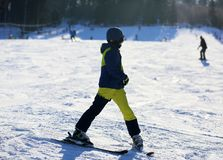Winter and winter sports that adolescents adore. Winter holidays in the open air stock image