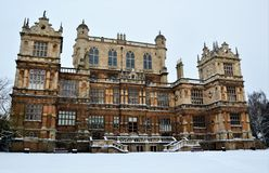 Winter wollaton hall. A snowy wollaton hall, nottingham, england. this building was wayne manor in the chris nolan batman trilogy. a fine example of an stock image