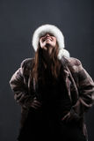 Winter woman. Happy girl in fur cap and coat Royalty Free Stock Photos