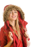 Winter woman. Portrait of young pretty woman wearing red hooded parka isolated on white background Royalty Free Stock Photo