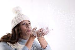 Winter Woman. Beautiful woman blowing powder snow Royalty Free Stock Photo