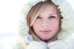 Winter woman. Portrait of blond young woman in fur coat at winter background Royalty Free Stock Images