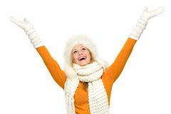 Winter woman with arms raised Stock Photo