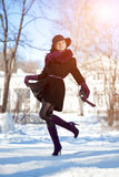 Winter woman on background of winter landscape, sun. Fashion gir Stock Image