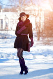 Winter woman on background of winter landscape, sun. Fashion gir Royalty Free Stock Image