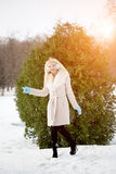 Winter woman on background of winter landscape? sun. Fashion gir Stock Photography