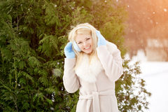 Winter woman on background of winter landscape? sun. Fashion gir Royalty Free Stock Image