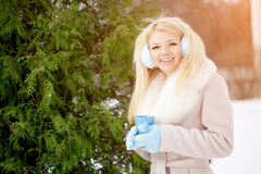 Winter woman on background of winter landscape? sun. Fashion gir Stock Photos