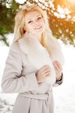 Winter woman on background of winter landscape? sun. Fashion gir Royalty Free Stock Photography