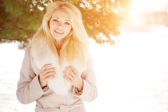 Winter woman on background of winter landscape? sun. Fashion gir Stock Image