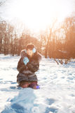 Winter woman on background of winter landscape, sun. Fashion gir Royalty Free Stock Photo