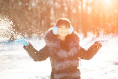Winter woman on background of winter landscape? sun. Fashion gir Royalty Free Stock Images