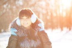 Winter woman on background of winter landscape? sun. Fashion gir Stock Photos
