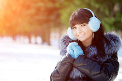 Winter woman on background of winter landscape? sun. Fashion gir Royalty Free Stock Photo