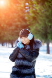 Winter woman on background of winter landscape? sun. Fashion gir Stock Photo