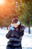 Winter woman on background of winter landscape? sun. Fashion gir Stock Photo