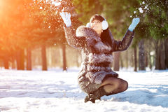 Winter woman on background of winter landscape? sun. Fashion gir Royalty Free Stock Photos