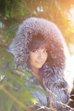 Winter woman on background of winter landscape? sun. Fashion gir Stock Images