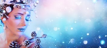 Winter Woman - Beauty Fashion Model Girl. With Snowy Pinecones stock images